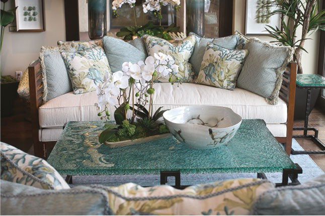 Beautiful couch decked with personal touches such as pillows, flowers, and more